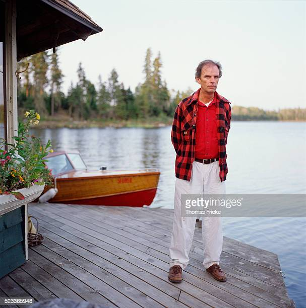 Man Standing Outside a Lake House