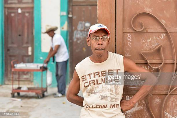 A man standing outside his house entrance in Havana city center For a week I explored the streets of Havana the homes and Havana's vastly diverse...