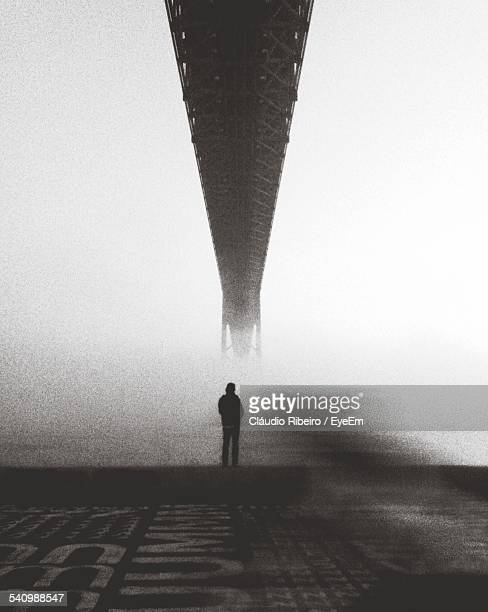 Man Standing Over April 25Th Bridge Against Clear Sky