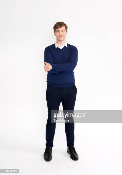 man standing - sweater stock pictures, royalty-free photos & images