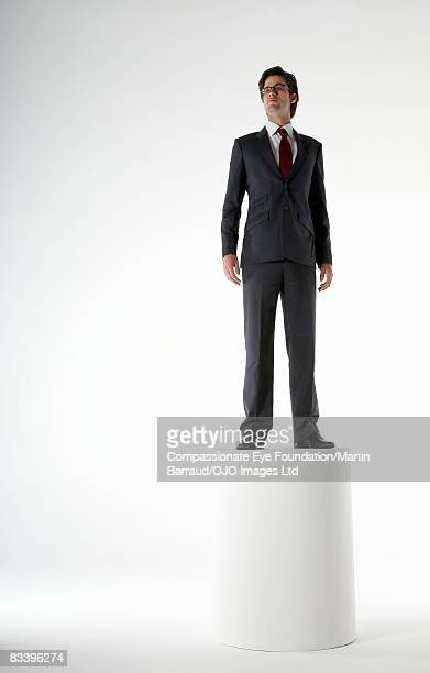 Man standing proud on a podium