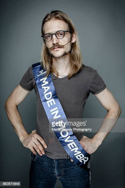 Man standing proud with Movember sash