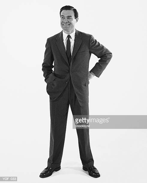 man standing, smiling - legs apart stock pictures, royalty-free photos & images