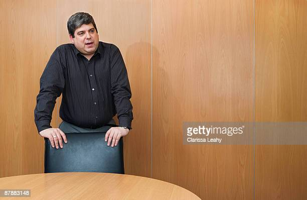 Man standing talking in boardroom
