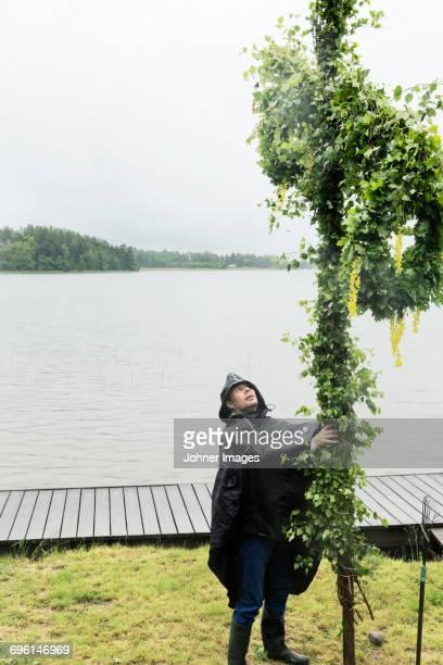 Man standing under maypole