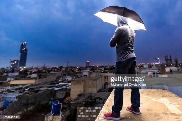 Man standing under umbrella