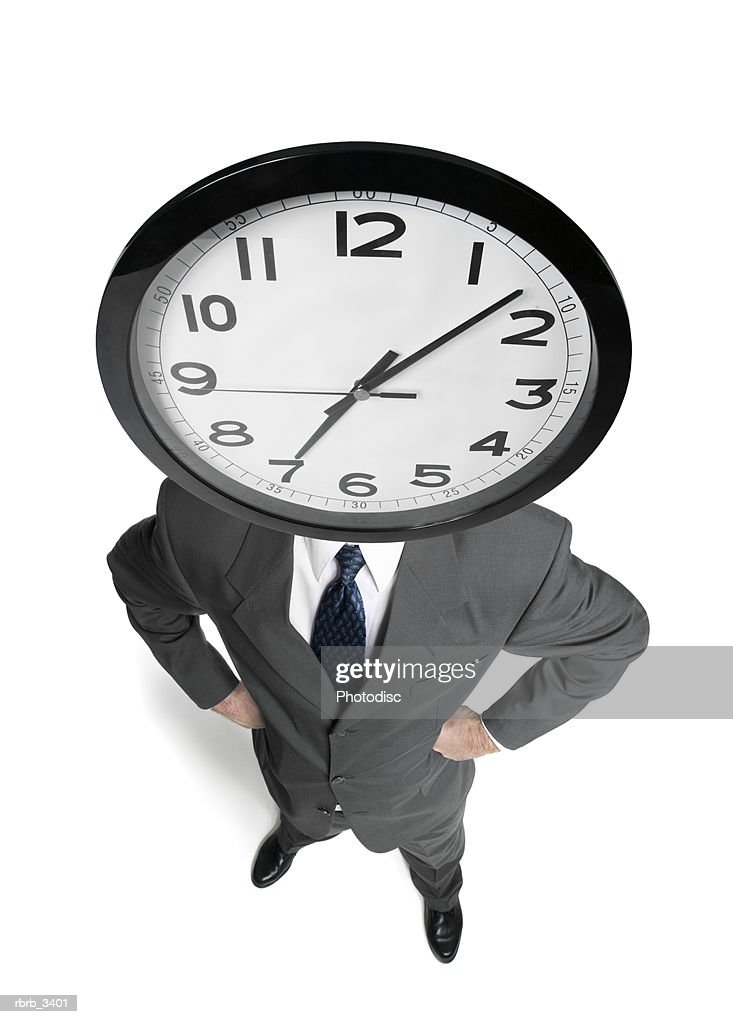 Man standing with a clock for a head : Foto de stock