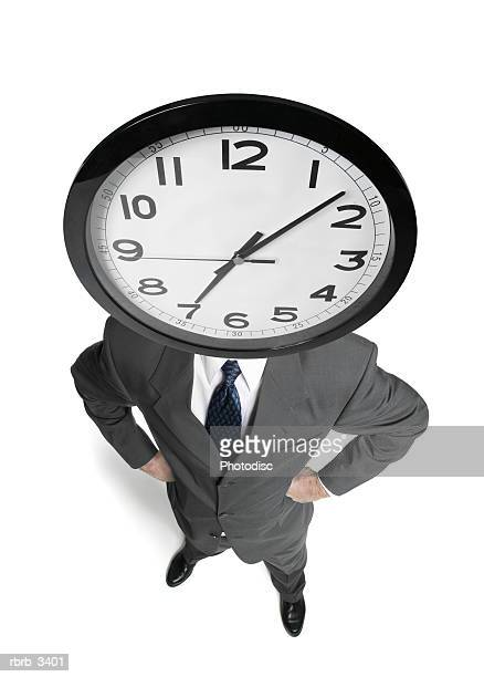 Man standing with a clock for a head