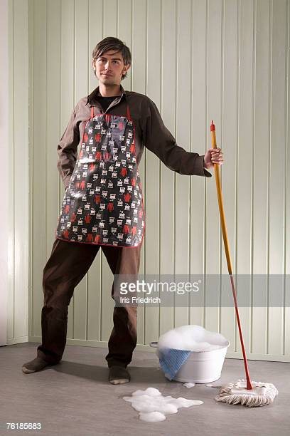 a man standing with a mop and bucket - daily bucket stock pictures, royalty-free photos & images