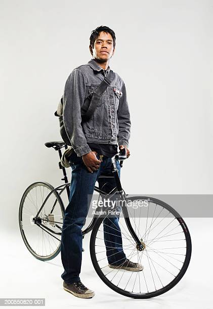 Man standing with bike, portrait
