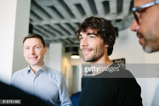 Man standing with colleagues at startup