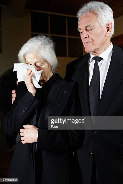 Man Standing with Crying Woman
