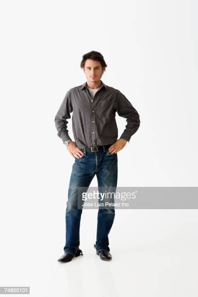 Man standing with hands on hips