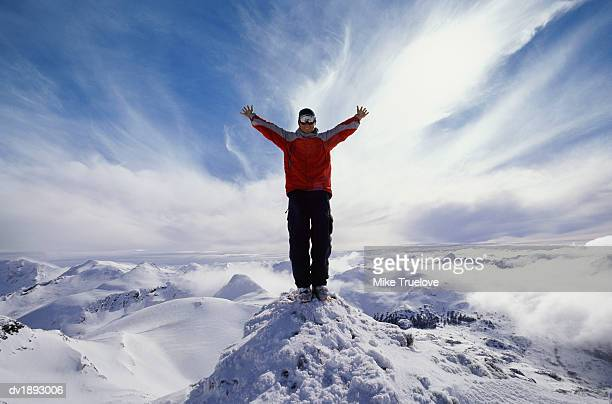Man Standing with His Arms Out on a Mountainside of Cerro Castor, Tierra Del Fuego, Argentina