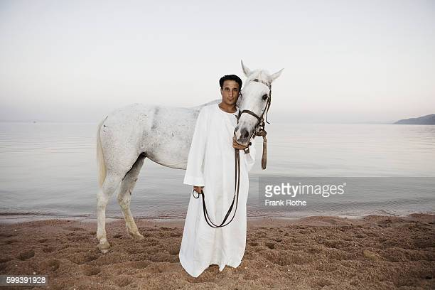 Man Standing with Horse