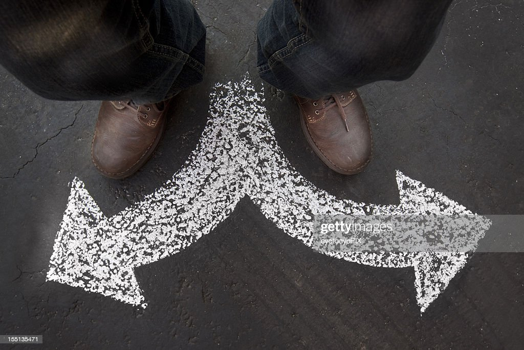Man Standing with Two Paths to Choose : Stock Photo