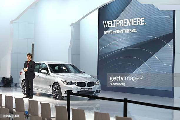 A man stands alongside the BMW 3 Gran Turismo automobile produced by Bayerische Motoren Werke AG ahead of the opening day of the 83rd Geneva...