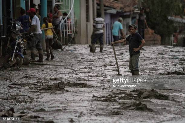 A man stands amid a muddy street after a mudslide due to heavy rains affected Corinto in Cauca department southwest Colombia on November 8 2017 The...