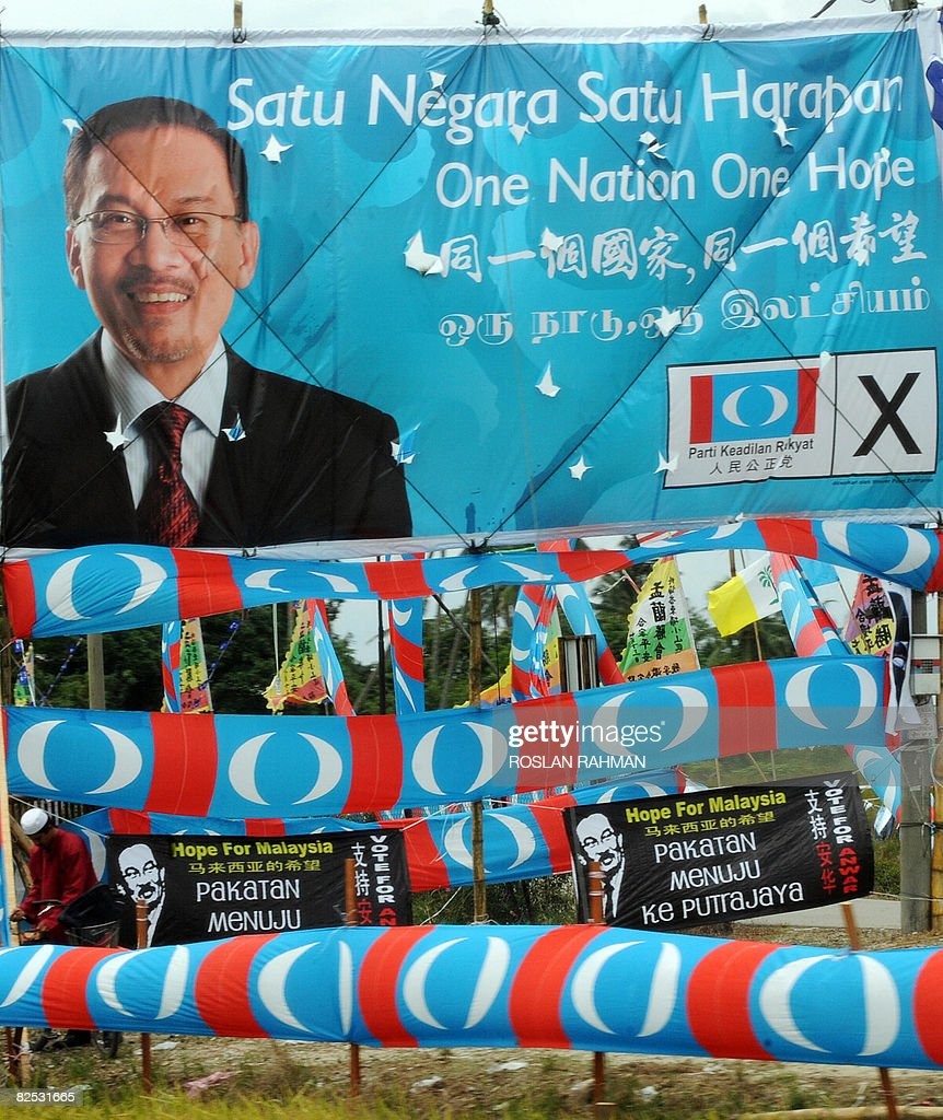 a man stands among party banners and a p pictures getty images