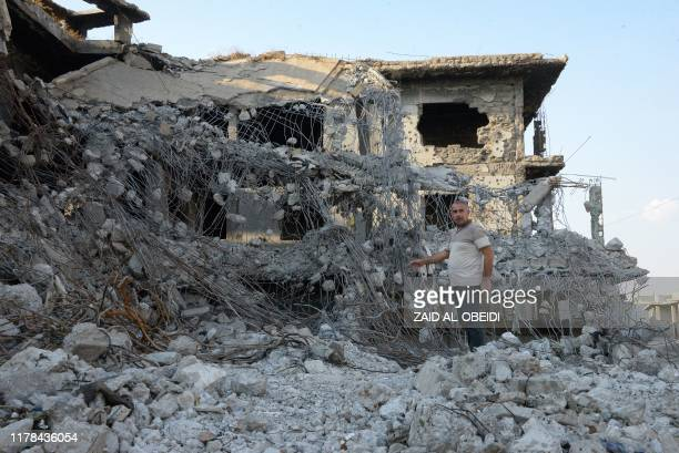 A man stands among the rubble of a destroyed building on October 27 2019 in the old city of Mosul the former base of the Islamic State group in...