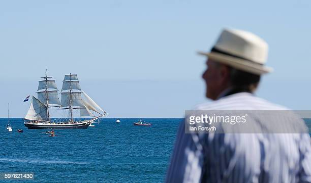 A man stands and watches as the the North Sea Tall Ships Parade of Sail leaves Blyth harbour on August 29 2016 in Blyth England The bustling port...