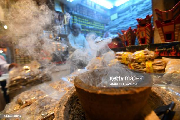 Man stands at a incense shop on November 26, 2018 in the Omani capital Muscat.