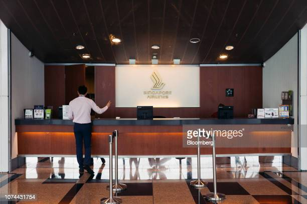 A man stands at a Singapore Airlines Ltd counter at Terminal 3 of Changi Airport in Singapore on Thursday Dec 13 2018 Singapore'sChangiAirport...