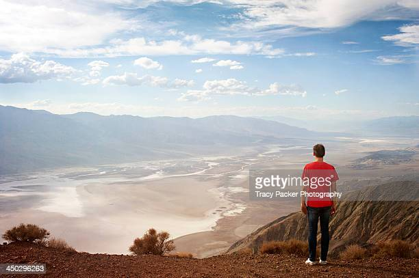 a man stands at dante's view, death valley - red shirt stock pictures, royalty-free photos & images