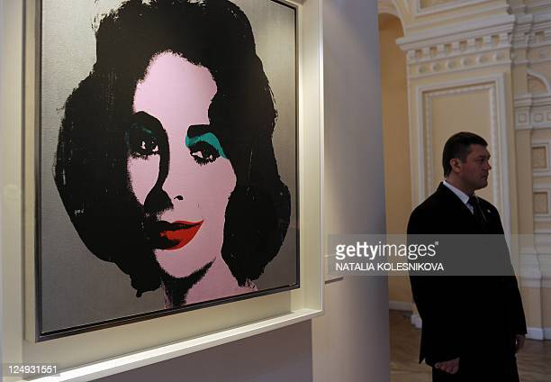 ADDITION A man stands at 'Silver Liz' by Andy Warhol displayed at Elizabeth Taylor's jewelry public exhibition in GUM on Moscow's Red Square on...