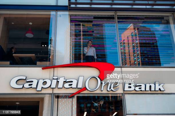 A man stands at the window of an office at a Capital One bank on April 17 2019 in New York City