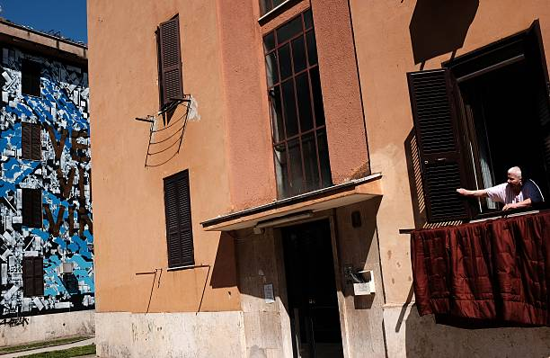A man stands at the window on April 9, 2015 in the Tor Marancia