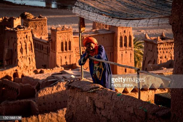 TOPSHOT A man stands atop the Kasbah of AitBenHaddou where scenes depicting the fictional city of Yunkai from the hit HBO television series Game of...