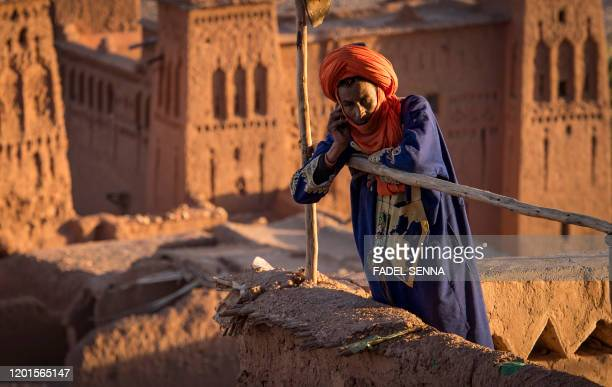 A man stands atop the Kasbah of AitBenHaddou where scenes depicting the fictional city of Yunkai from the hit HBO television series Game of Thrones...