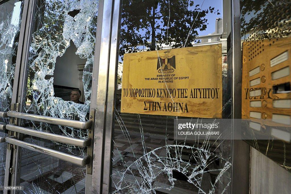 a man stands behind smashed doors of a b pictures getty images