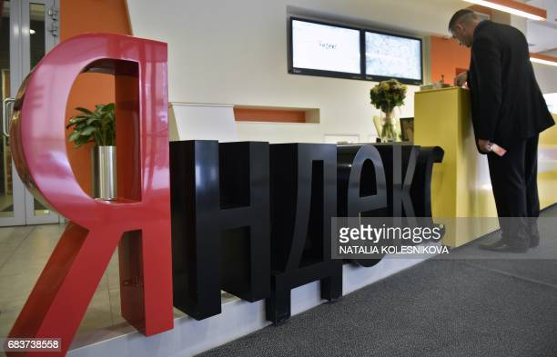 A man stands by a sign of Yandex company Russia's internet search engine inside its headquarters in Moscow on May 16 2017 Ukraine on May 16 blocked...