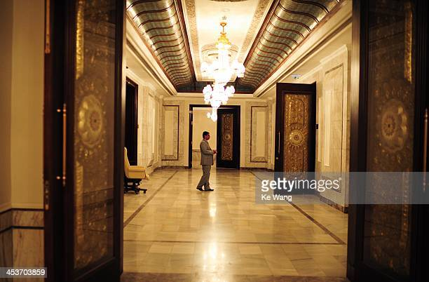 Man stands by at the backstage of the 23rd Arab League Summit at the presidential palace in Baghdad of Iraq,March 28, 2012.