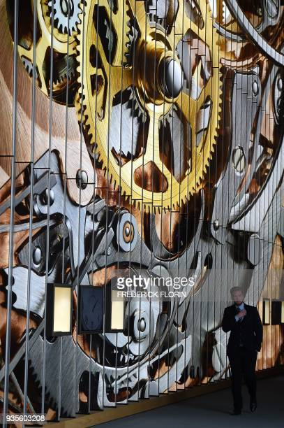 A man stands by the stand of Swiss watchmaker Blancpain on March 21 2018 in Basel Switzerland during press day on the eve of the opening of the...