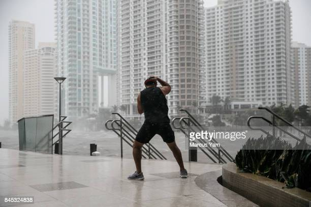 A man stands firm against the wind by the Miami river as the water lever surges during the passing of Hurricane Irma in Miami Fla on Sept 10 2017