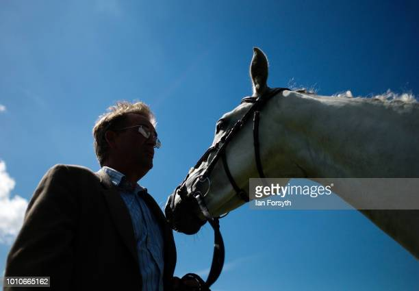 A man stands holding his horse during 152nd the Ryedale Country Show on July 31 2018 in Kirbymoorside England Held in Welburn Park near Kirbymoorside...