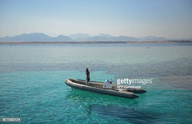 A man stands in a boat in the Egyptian Red Sea resort of Sharm elSheikh on August 7 2017 Saudi Arabian billionaire Prince Alwaleed bin Talal is to...