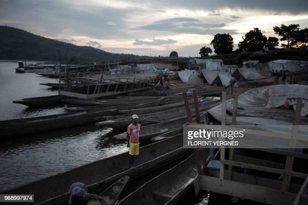 A man stands in a boat on June 2 2018 in the port of Sao welcoming several hundred travellers a day crossing the river Oubangui to connect the...