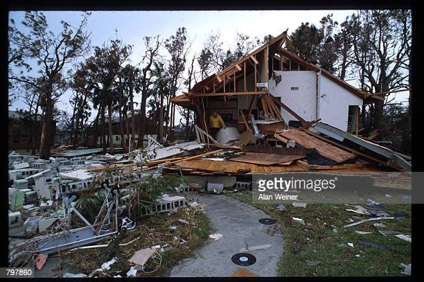 A man stands in a partially destroyed house September 27 1989 in South Carolina Hugo is ranked as the eleventh most intense hurricane to strike the...