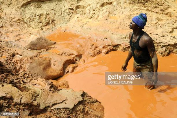 A man stands in a pool of water in a gold mine on February 23 2009 in Chudja near Bunia north eastern Congo The conflict in Congo has often been...