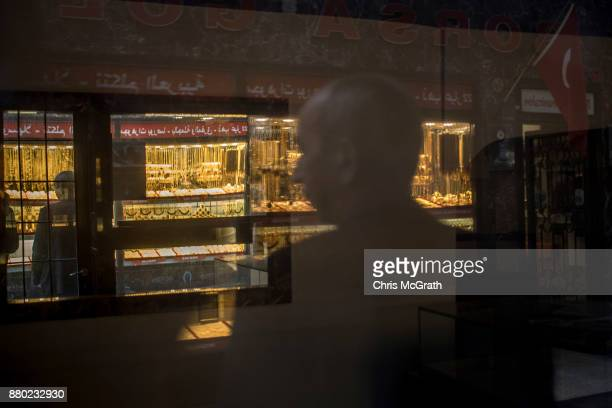 A man stands in front of a gold store on November 27 2017 in Istanbul Turkey The trial of Mr Reza Zarrab an IranianTurk who ran a foreign exchange...