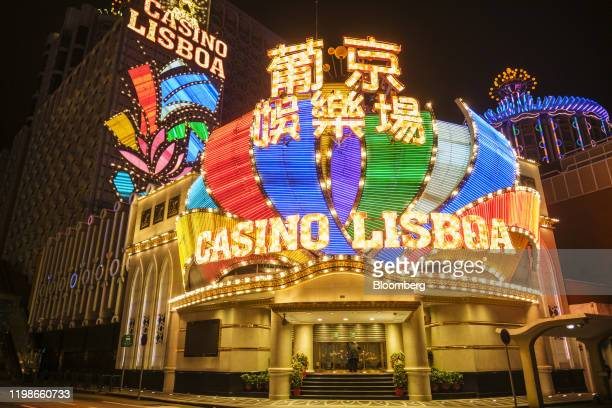 Man stands in front of a half shuttered entrance to Casino Lisboa, operated by SJM Holdings Ltd., in Macau, China, on the early morning of Wednesday,...