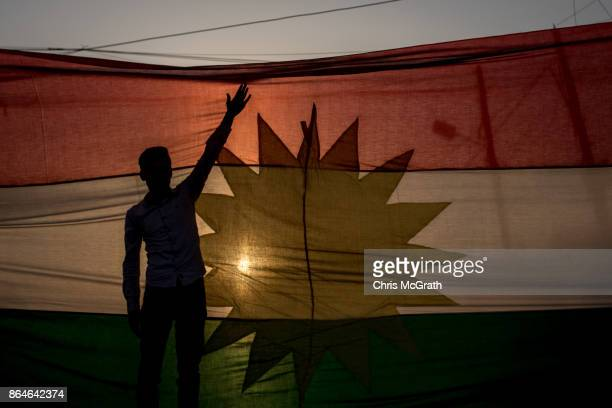 A man stands in front of a Kurtdish flag during a protest outside the US Consulate on October 21 2017 in Erbil Iraq The demonstration was held to...