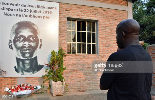 Man stands in front of a plaque in honor of Burundian journalist Jean Bigirimana during a commemoration to mark one year after the disappearance of...