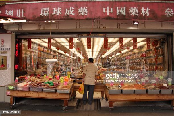 A man stands in front of a store at Chinatown on May 28 2020 in Vancouver Canada The Coronavirus pandemic has spread to many countries across the...