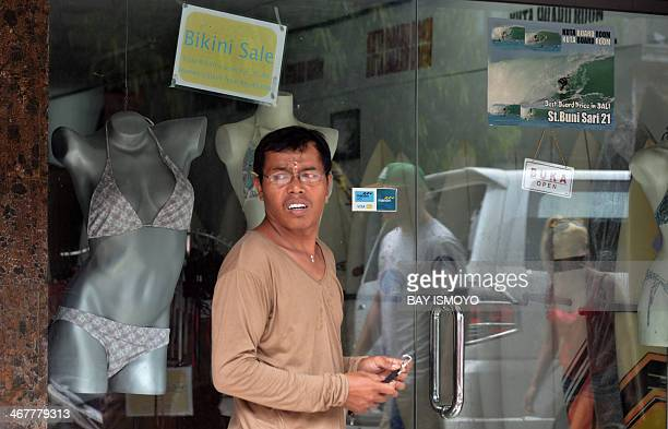 A man stands in front of a surfing and bikini shop that belongs to Australian drug trafficker Schapelle Corby's sister Mercedes Corby in Kuta on...