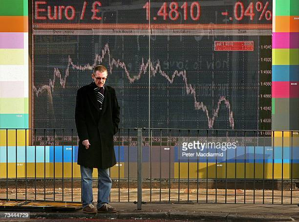 A man stands in front of an electronic sign displaying stock price information on February 28 2007 in London World stock prices have tumbled after...